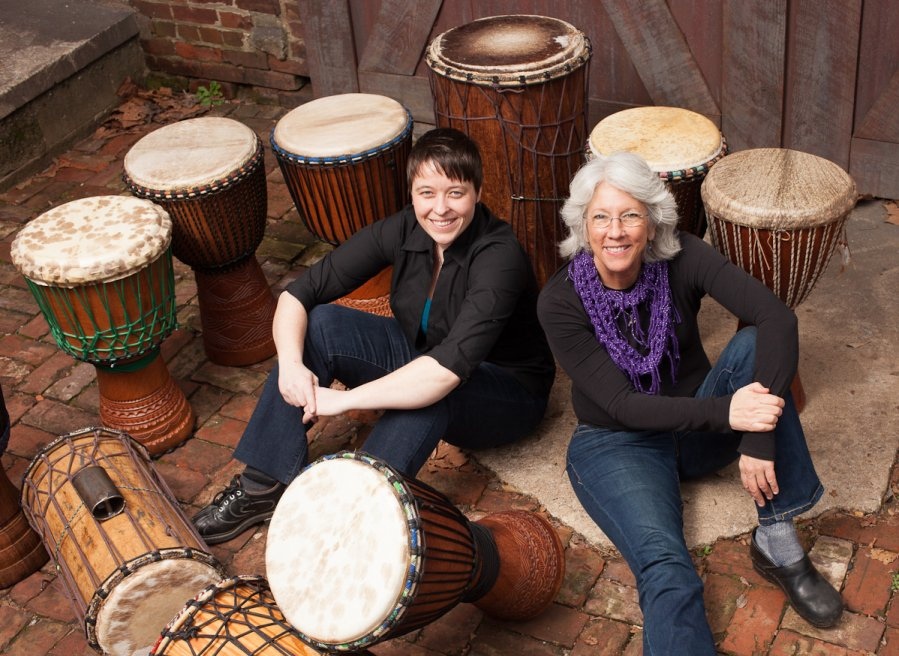 DrumRise - Colleen Caffrey and Amy Jackson amidst their djembe and dunun drums